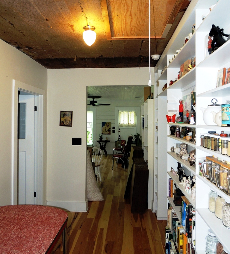Additional shelves were added to hall and Pantry was enlarged