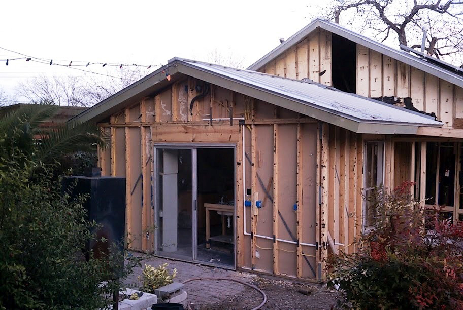 Asbestos siding was removed and wiring rebuilt from the exterior