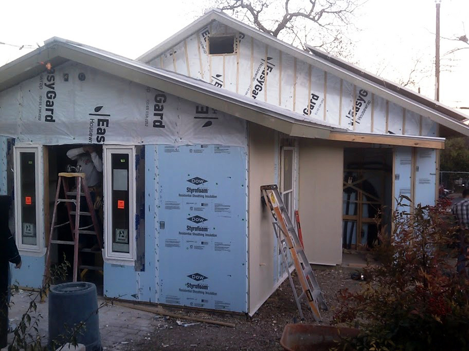 Insulated sheathing was added to help with cold spots where studs penetrated insulation.